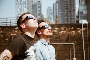 men look at sun